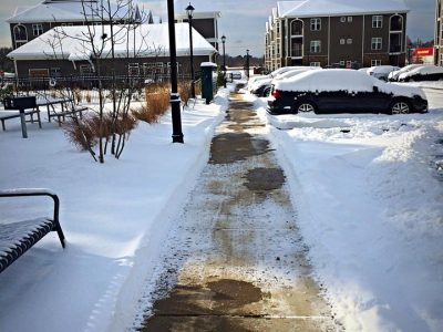 sidewalk clear of snow on a sunny day